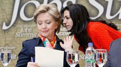 Huma whispers in Hillarys ear